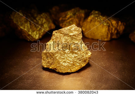 stock-photo-closeup-of-big-gold-nugget-finance-concept-380082043