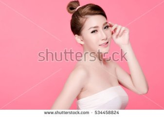 stock-photo-short-hair-asian-young-beautiful-woman-smile-and-point-on-her-head-isolated-over-pink-background-534458824