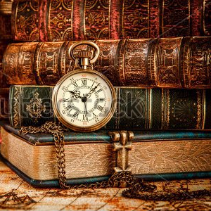 stock-photo-vintage-antique-pocket-watch-on-the-background-of-old-books-383151490